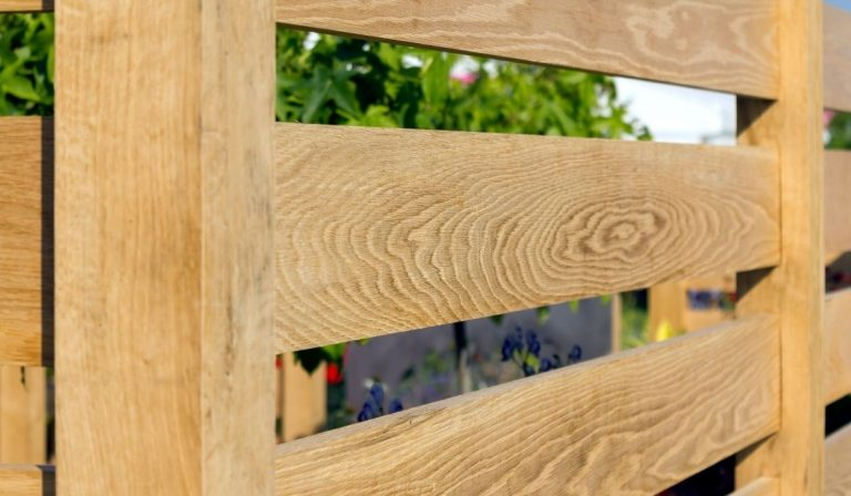7 Tips for Making a Fence Out of Landscape Timbers
