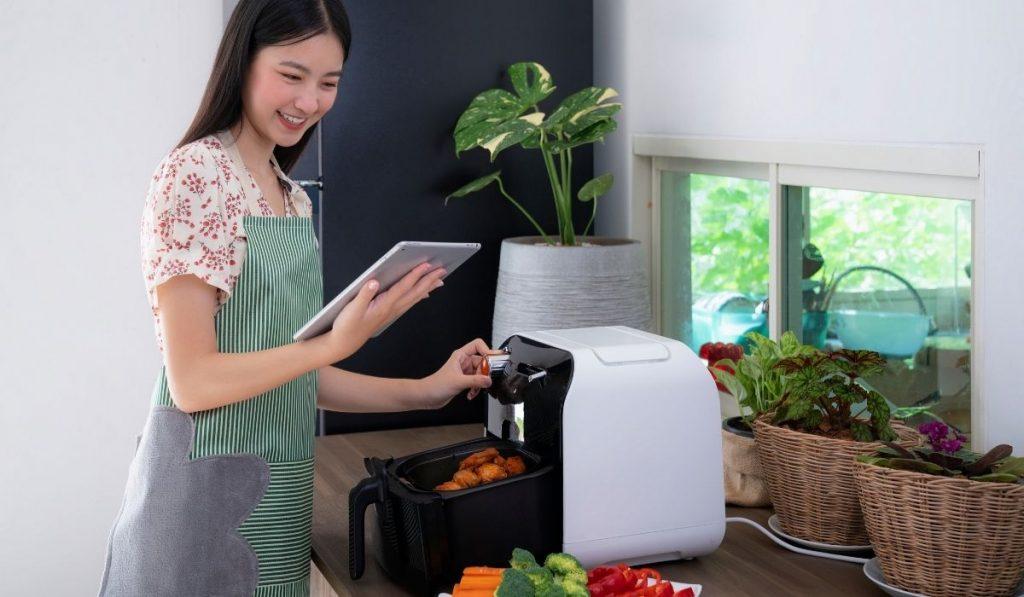 Woman cooking in air fryer