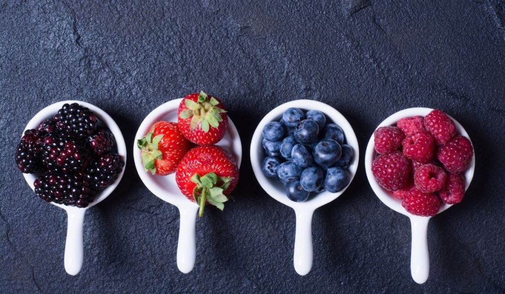 different berries on a small cup bowl