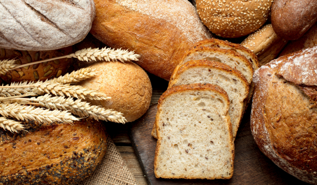 different kinds of breads on a wooden table