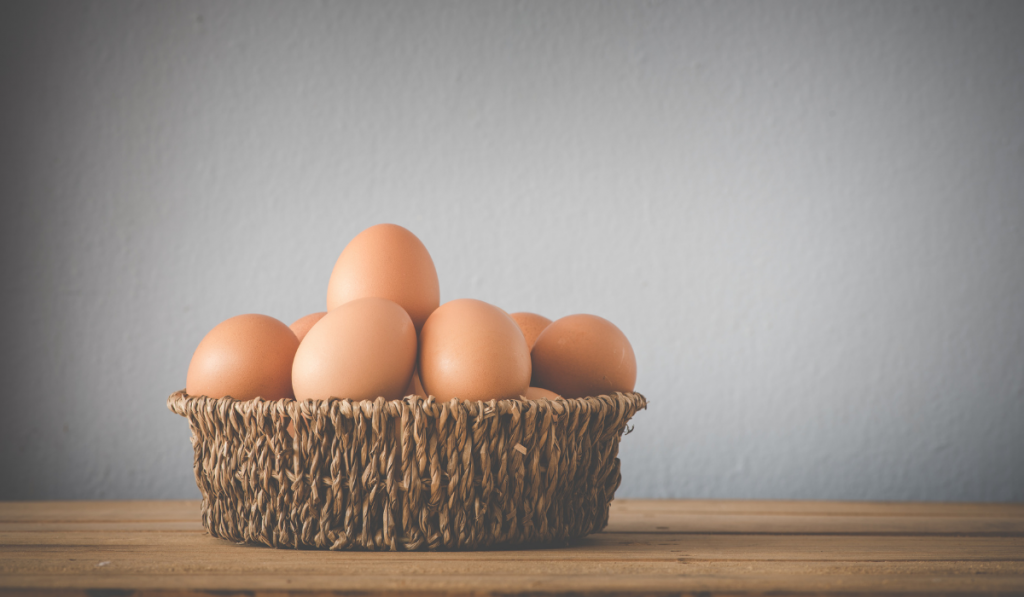 Eggs inside a wooden crate with white background