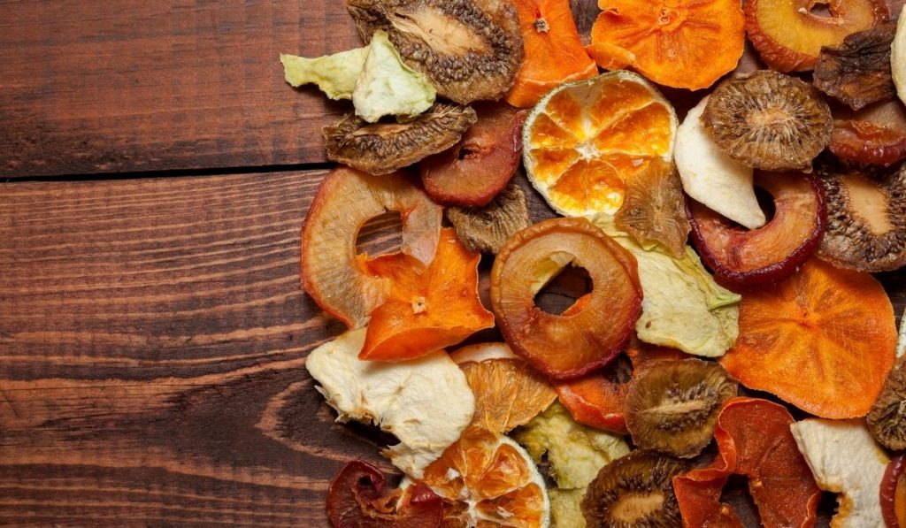 different dried fruits on a wooden table